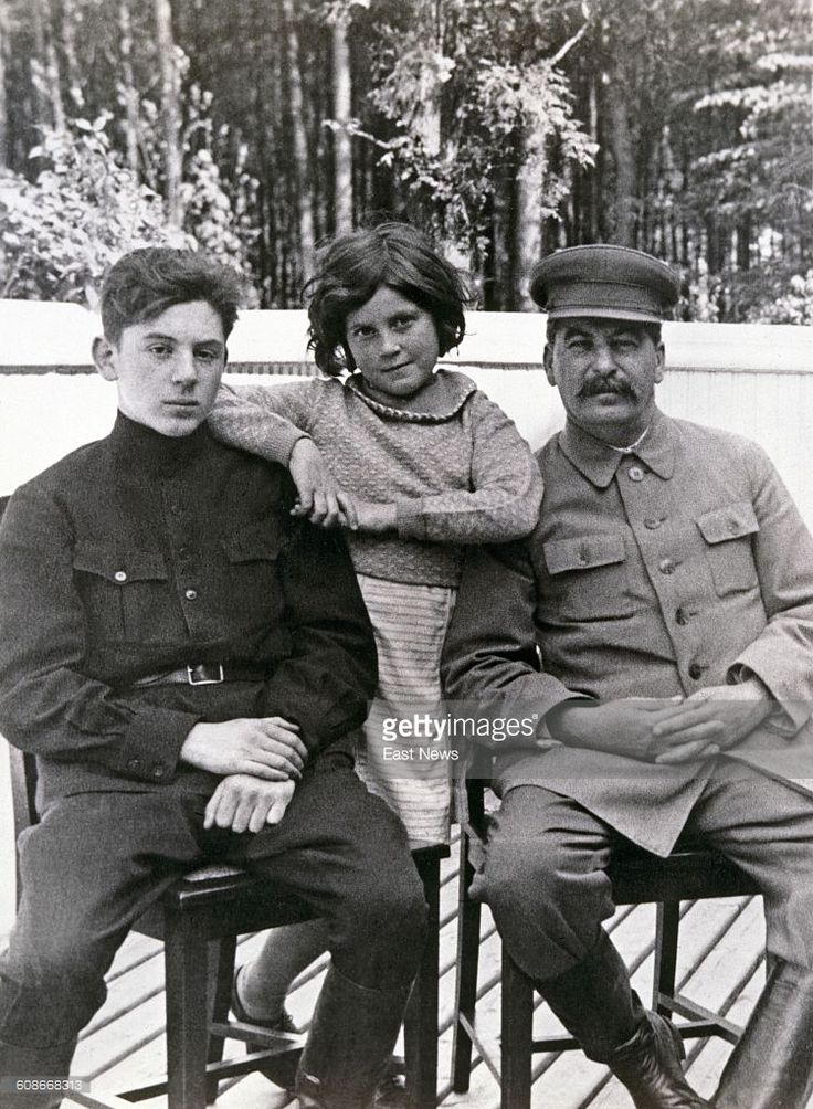 Soviet leader Joseph Stalin (1878 - 1953, right) with his son, Vasily (1921 - 1962) and daughter Svetlana (1926 - 2011) at one of Stalin's dachas, former Soviet Union, June 1935. Both children are by Stalin's second wife, Nadezhda Alliluyeva. The photograph was taken by Stalin's head of personal security, Nikolai Vlasik (1896 - 1967).