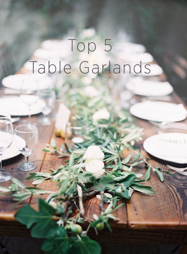 TOP 5 WEDDING RECEPTION TABLE GARLANDS:  #1. stunning olive branch and fig leaf garland