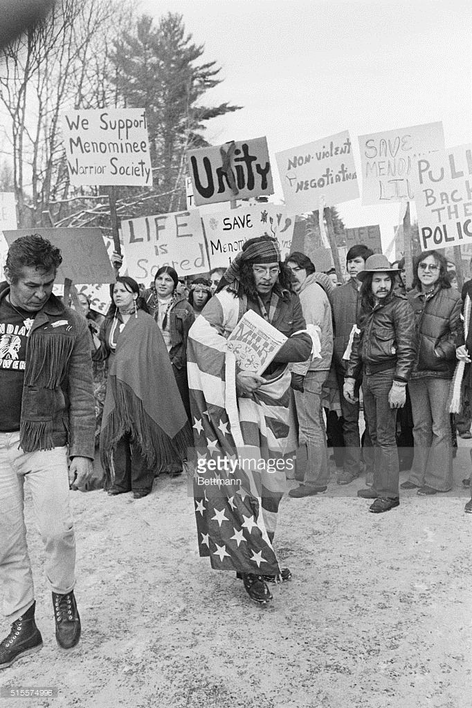 Native American Protesters One Wearing An American Flag Gather At A Police Roadblock Near The Alexian Native American Protest Native American Warrior Society
