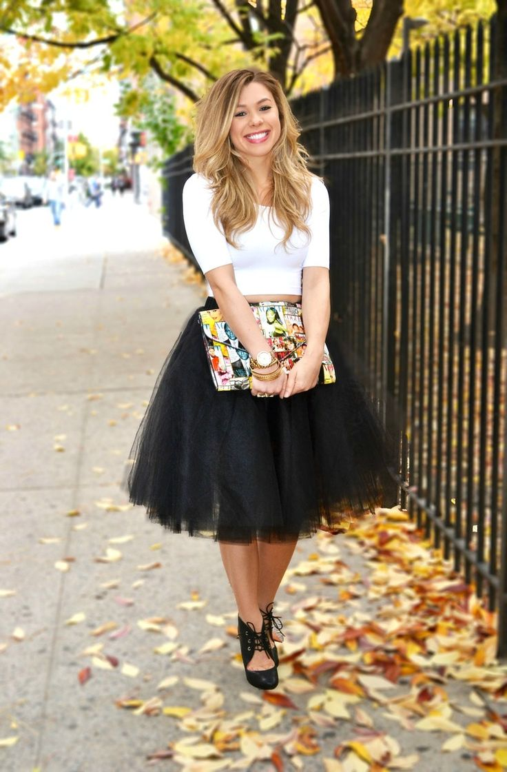 This combination of white cropped top and a black pleated tulle midi skirt is perfect for off-duty occasions. Black cutout leather lace-up ankle boots will bring a classic aesthetic to the ensemble.  Shop this look for $234:  http://lookastic.com/women/looks/white-cropped-top-white-clutch-black-midi-skirt-black-lace-up-ankle-boots/4928  — White Cropped Top  — White Print Leather Clutch  — Black Pleated Tulle Midi Skirt  — Black Cutout Leather Lace-up Ankle Boots