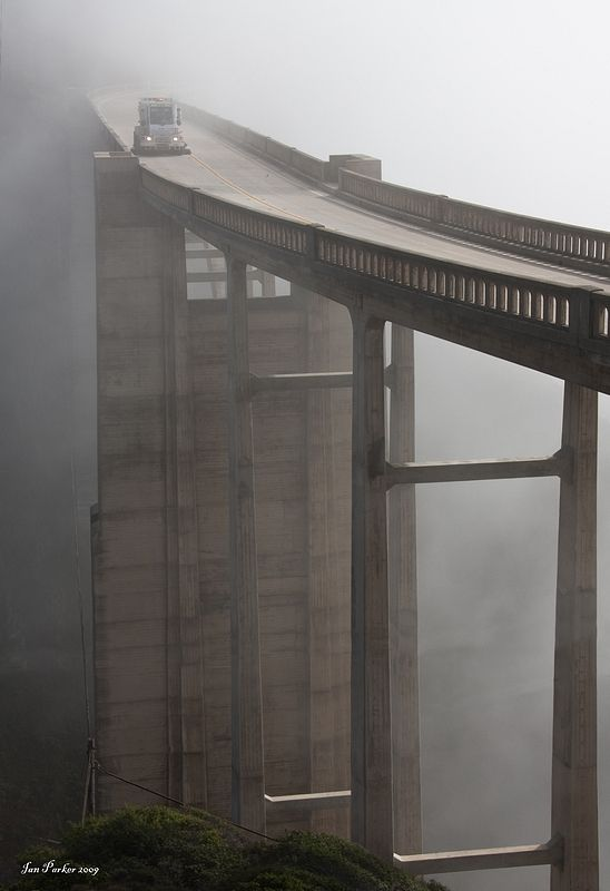 Look closely at the bridge sweeper vehicle cleaning Bixby Bridge (Big Sur, CA) in the fog and mist.  Great photo.