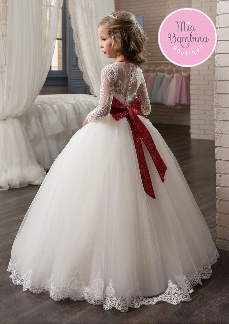 The breathtaking Richmond flower girl dress features straight cut illusion bodice with long lace transparent sleeves and a floor-length richly gathered tulle skirt. The bodice is made of all-over lace
