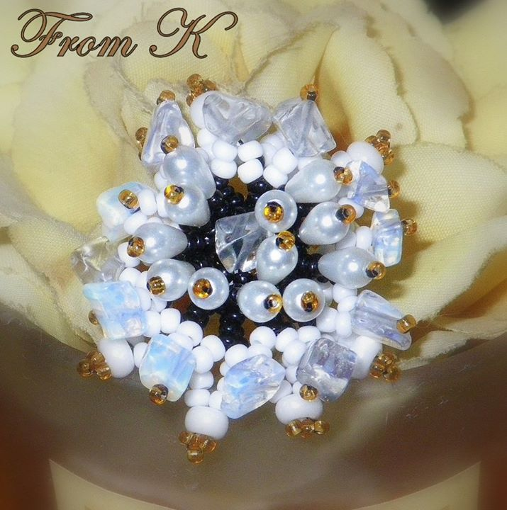 Cocktail Bead-weaved Flower  Ring. One of a kind handmade beaded cluster with crystal quartz ring. An elegant statement ring. Entirely handmade with Czech glass seed beads, glass crystals and crystal quartz gem stones.  About 3 cm in diameter.  25.00 Ron