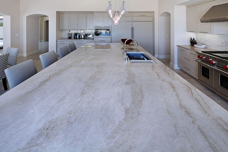 Neutrals play nicely! Neutral countertops like Taj Mahal are striking enough to stand on their own, but muted enough to pair well with higher-octane hues.