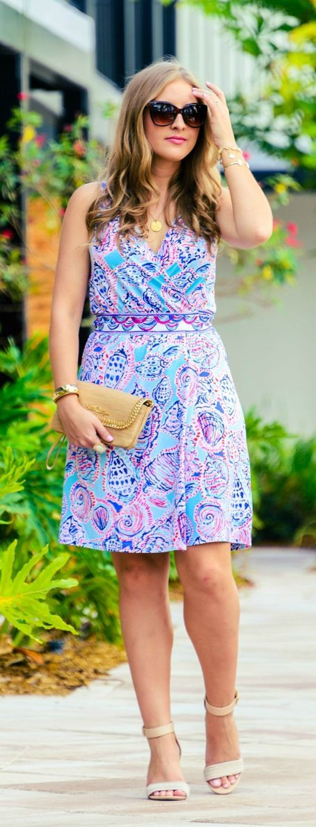 Summer in Lilly! Love this Lilly Pulitzer wrap dress styled by Orlando fashion blogger Ashley Brooke Nicholas at The Gates Hotel in Key West. Such a fun vacation outfit idea!