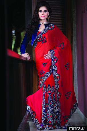 New Red georgette saree in stone & zari work with multi colour velvet border & red blouse along with red & royal blue blouse in golden zari border to give you a glam look.