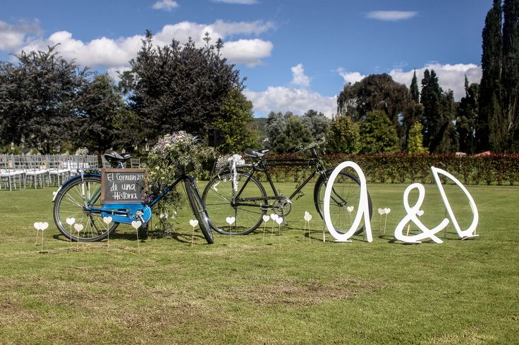 Bride and groom bicycle + wooden initial letters; great idea for guest to take pictures with