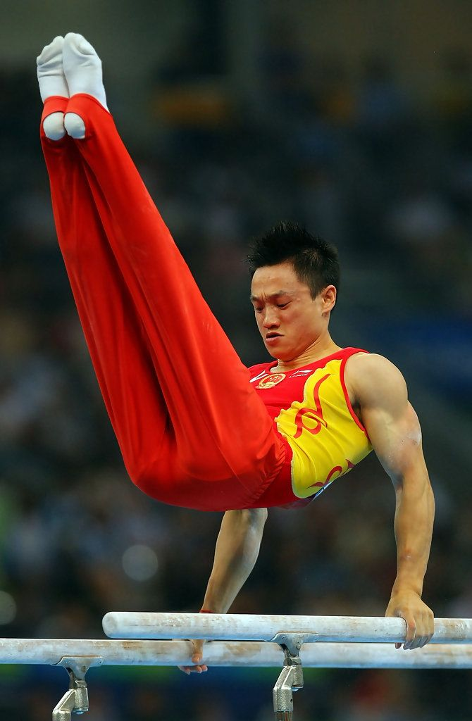 Yang Wei of China competes on the parallel bars during the men's individual all-around artistic gymnastics final at the National Indoor Stadium during Day 6 of the Beijing 2008 Olympic Games on August 14, 2008 in Beijing, China. Yang won the gold medal.