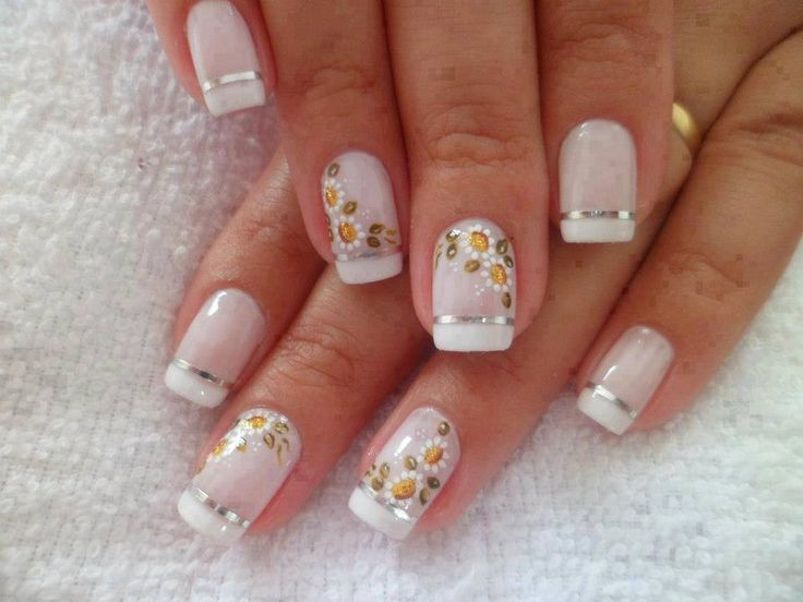 Traditional White Tip French Manicure with silver  Nail tape, small white daisies, free-hand nail art       35 The Coolest Nail
