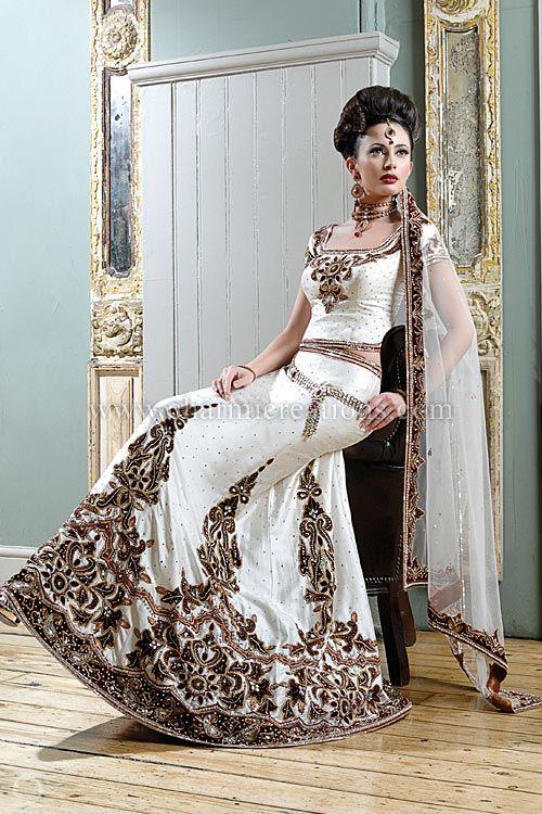 Traditional Wedding Dresses - Off White raw silk bridal chaniya choli with maroon velvet patchwork embroidery and net dupatta