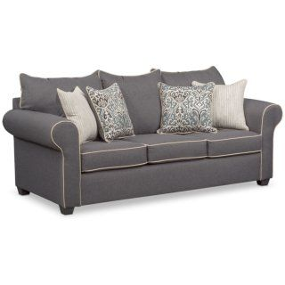 Charmed Living. With a blend of contemporary colors and traditional, decorative accents, the Carla sofa brings a current, trendsetting aesthetic to any home. Roll arms and contrast piping deliver timeless style, while the gorgeous gray upholstery perfectly matches any décor. Accent pillows complete the look of this stylish, affordable and functional group.