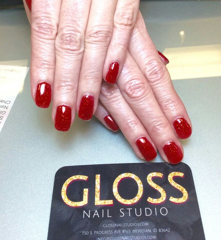 Ruby Red Nails  by Angie Heinemann  Gloss Nails:  Schedule an appointment today  (208)887-8548