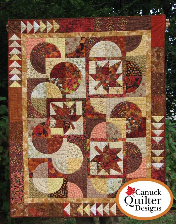 Pieced lap and throw for Fall. Autumn Moons Quilt Pattern CQD-1089e by Canuck Quilter Designs - Joanne Kerton.  Check out more of our quilt patterns. https://www.pinterest.com/quiltwomancom/quilts/  Subscribe to our mailing list for updates on new patterns and sales! https://visitor.constantcontact.com/manage/optin?v=001nInsvTYVCuDEFMt6NnF5AZm5OdNtzij2ua4k-qgFIzX6B22GyGeBWSrTG2Of_W0RDlB-QaVpNqTrhbz9y39jbLrD2dlEPkoHf_P3E6E5nBNVQNAEUs-xVA%3D%3D
