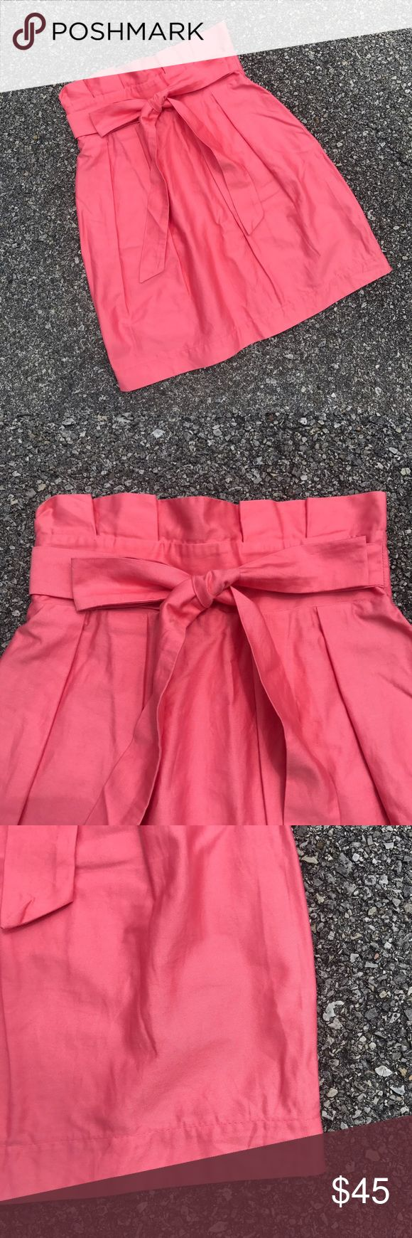 """Frill Clothing Carolina Bow High Waist Skirt Stop. Seek no further. I have found the most adorable skirt in the world. This guy is the most gorgeous Pink I've ever seen. Ties at the front with a darling bow and comes up in a slight flare with a small v cut at the back. Incredibly flattering. Perfect condition. Size 0. Waist measures 12"""" at the band laid flat and 19"""" long. Anthropologie Skirts Mini"""
