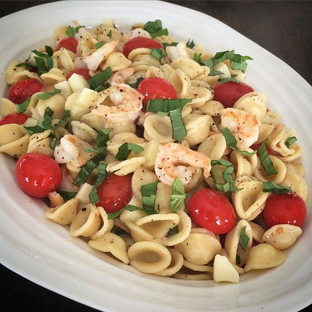 Tonight's dinner is a family favourite. This flavourful dish tastes great hot or at room temperature.  Orecchiette with tomatoes, mozzarella, basil and shrimp. @zimmysnook