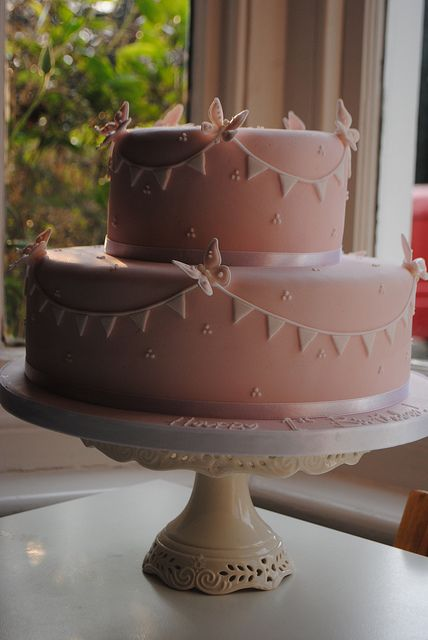 Pink bunting and butterflies cake.