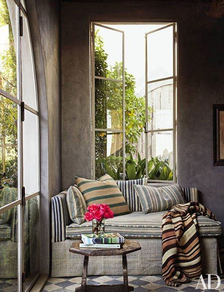 In the corner of a Malibu, California, library, a striped daybed offers a cozy place to read. Pin it.