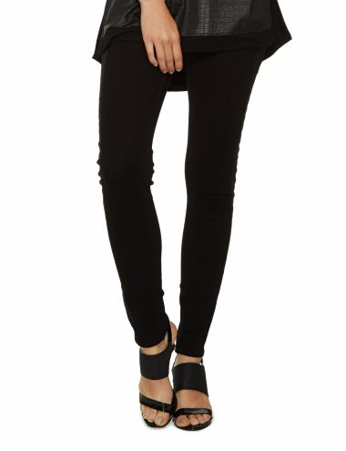 A pair of slim leg jeans featuring printed side panel details. They have five pockets.