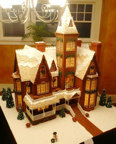 This gingerbread beauty stands four feet tall and is made with 40 pounds of gingerbread and 30 pounds of royal icing. Created by Eduardo M. of Omaha, NE. See more details of this Grand Victorian gingerbread house.