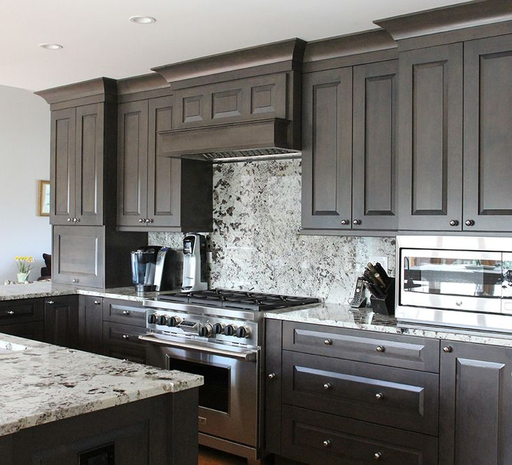 Alder cabinets with a dark stain. Tons of storage in not a ...