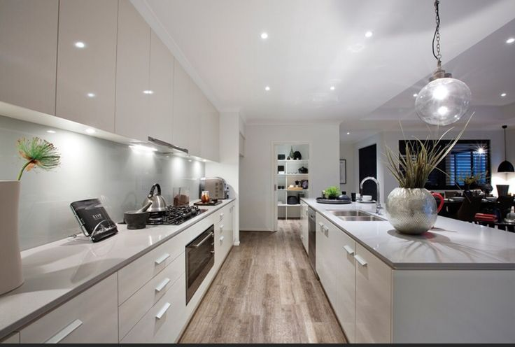 White gloss cabinets + with soft grey stone tops
