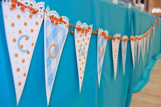 Doily-trimmed bunting.  Love the pom-pom ribbon used, too.