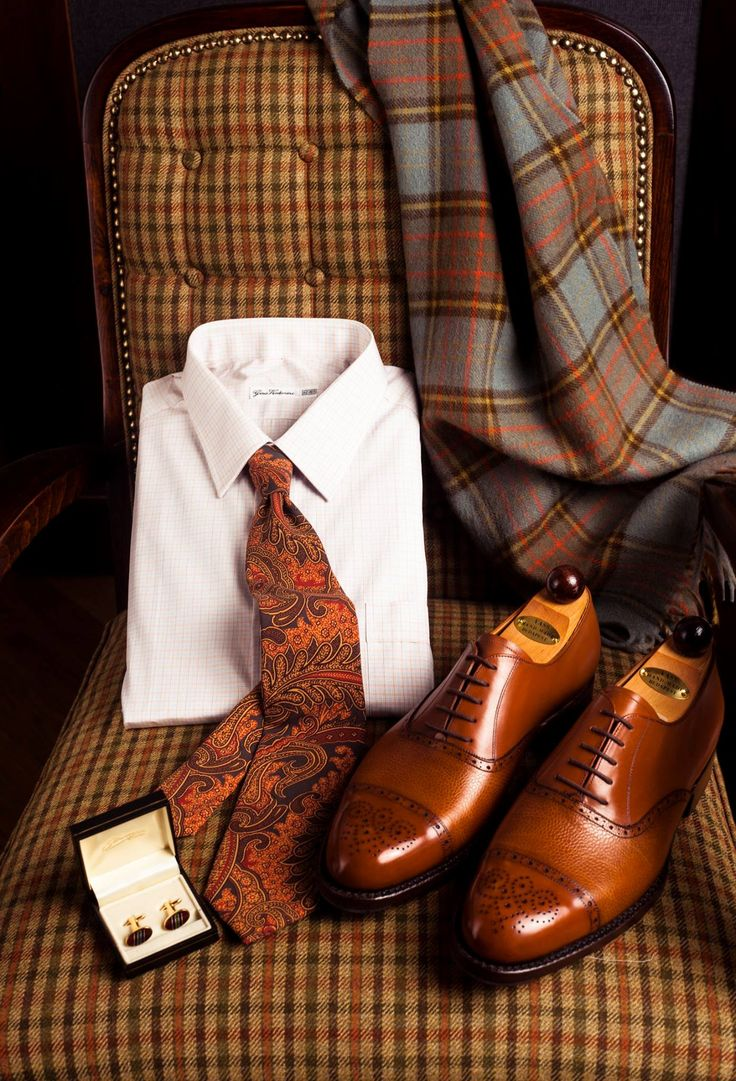 For a stroll along Piccadilly, and up through Mayfair, the timeless classics are always stylish: Paisley, Tartan and Brogues - perfect!   • Lambswool Tartan scarf, silk twill Paisley tie by Drake's, shirt by Gino Venturini, and bijou cufflinks, all from Simon Skottowe Bespoke Tailors  • Mixed leather Old English Oxford shoes by Vass Shoes / Vass Cipő