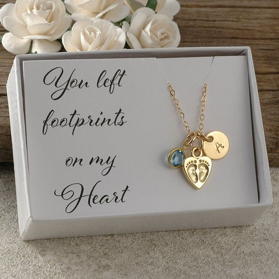 A gold heart with baby feet necklace. This comes in a gift box with a card that reads You left footprints on my Heart. Miscarriage jewelry, baby loss, infant loss, birthstone, initial, pregnancy loss, sids, stillborn, stillbirth