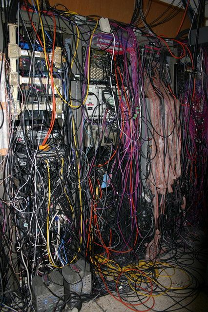 "Sadly, this is what most real world Cabling Work looks like. These are the same folks that gripe that they don't like their cables ""tied down"". Seriously, the server room isn't an experiment, it is a ""BACKBONE"" and must be supported as such. It takes as long to untangle as it does to pull past some Velcro straps!"