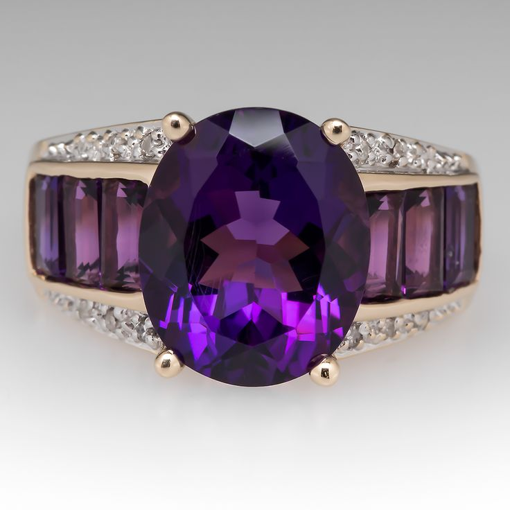 AMETHYST GEMSTONE RING DIAMOND ACCENTS 14K GOLD. This beautiful amethyst gemstone ring features a large oval cut center and emerald cut amethyst accents. The ring is crafted of 14k gold and has some small diamond accents at the top as well. The ring has a lighter weight construction but it is all about the color with this one.