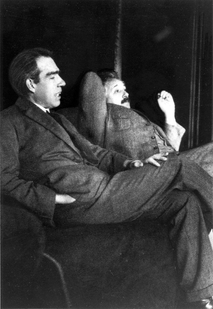 Niels Bohr and Albert Einstein at the Bohr-Einstein debates over quantum mechanics.