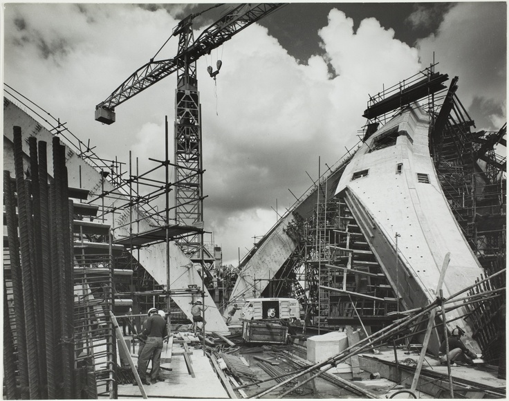 Jorn Utzon Sydney Opera House photographs : construction site / photographed by Max Dupain, 1964 . Find more information about this photograph: http://acms.sl.nsw.gov.au/item/itemDetailPaged.aspx?itemID=52816. From the collection of the State Library of NSW http://www.sl.nsw.gov.au/