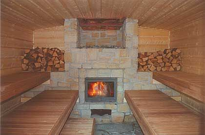 commercial saunas | The wood-fired sauna-stove ist built with natural stones.