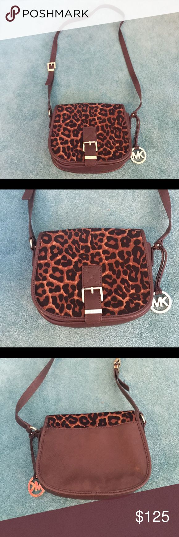 💙Michael Kors Crossbody Bag❤️ Beautiful MK leopard cross body bag with brown leather and gold logo.  Good condition! Small size bag Michael Kors Bags Crossbody Bags