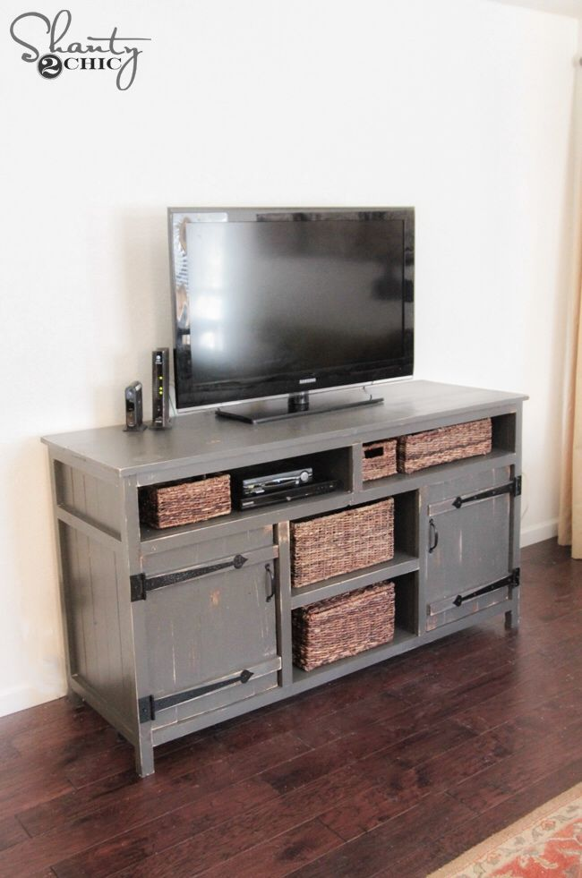 DIY Media Console: How great is this? Not to big and bulky, its full of storage spaces and its a fantastic DIY project made easy thanks to @Shanty2Chic and the tutorial they made for us! Love the look and the distressing using Rust-Oleum Kona Wood Stain!