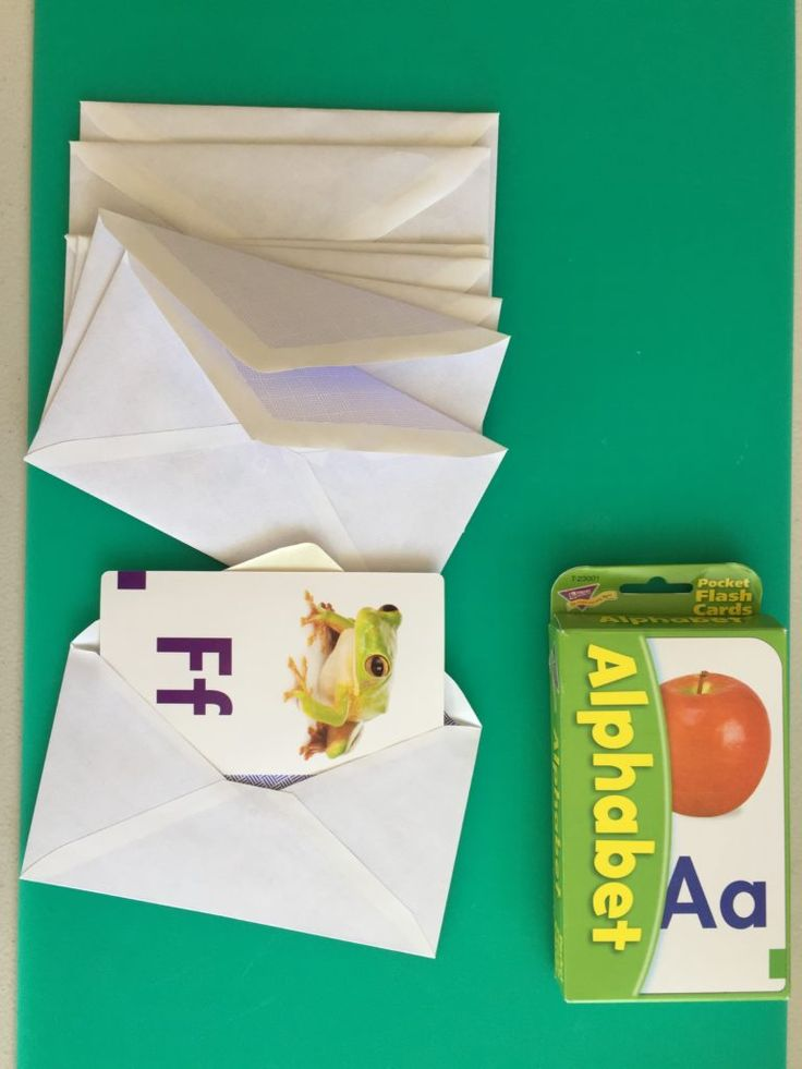 Wednesday box of activities, taking flashcards out of envelopes, activities for 14 month olds, activities for 15 month olds, activities for 16 month olds, activities for 17 month olds, activities for 18 month olds, activities for toddlers, activities for 19 month olds, activities for 20 month olds