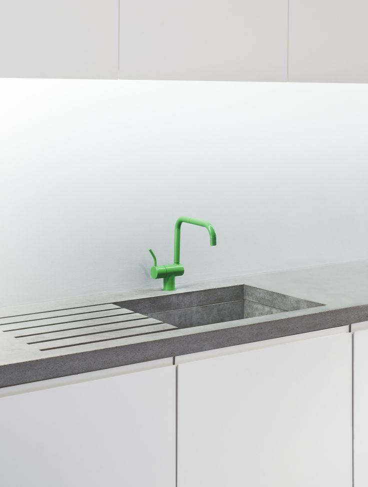 An electric green Vola tap offset against the ground aesthetic of lowinfo concrete. Lightly sealed the basin will patina and erode over time expanding the void between the two contrasting components. #design