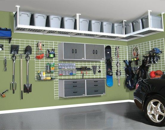 Ceiling tote rack, pegboard background, and colorful walls for the garage