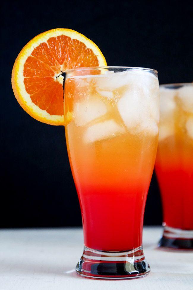 Corona Sunrise Cocktail with tequila, orange juice, grenadine and Corona Extra.