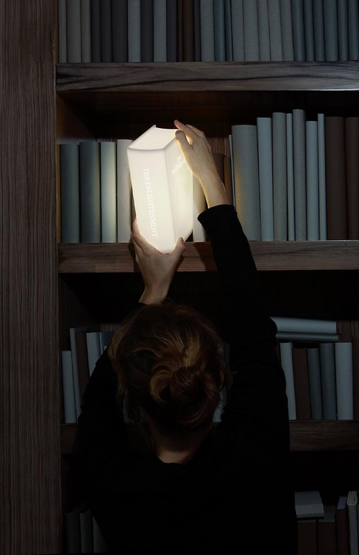 "The ""Enlightenment Book"" lamp actually provides you with light and literally looks like a magically glowing book!"