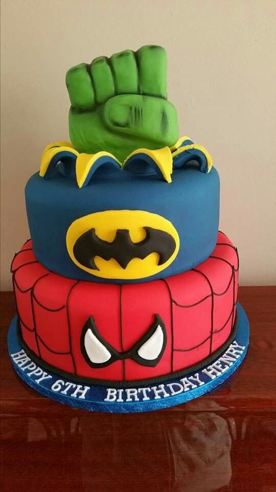 Superhero themed birthday cake. Spiderman -batman and hulk fist. All handmade decorations by Toppers cakes, and Cupcakes.
