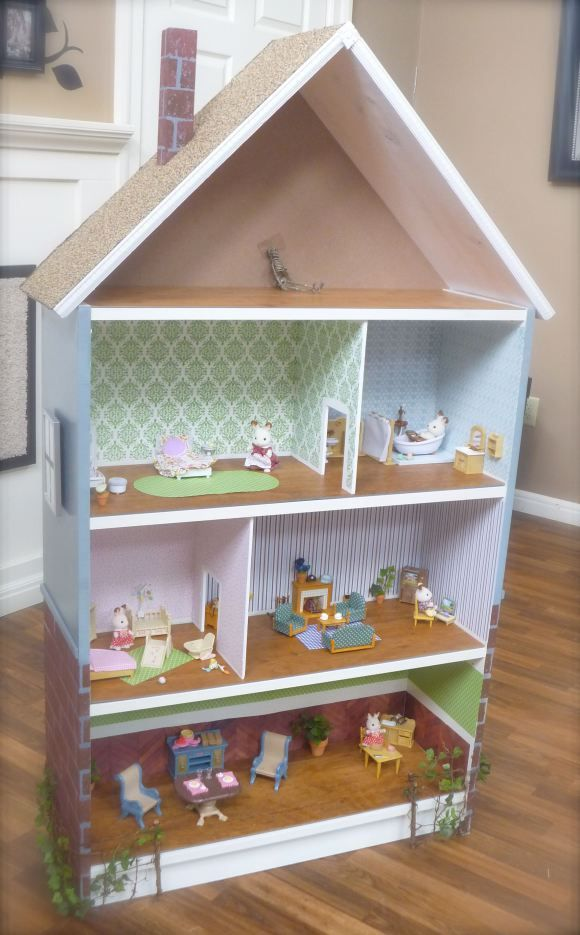 A BILLY bookcase is transformed into a DIY Dollhouse. Miniature furniture sold (and assembled!) separately