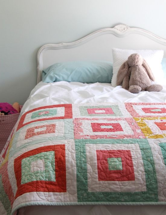 This quilt has been sitting on Sophie's bed for a couple of months and has already been used, loved, and washed during the warm summer.I backed it with minky fabric, and Kathy quilted it for…