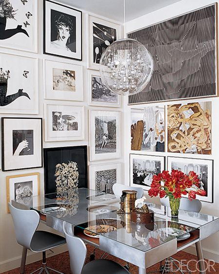 gallery walls... and notice the decorative plates incorporated into the table | Elle Decor...