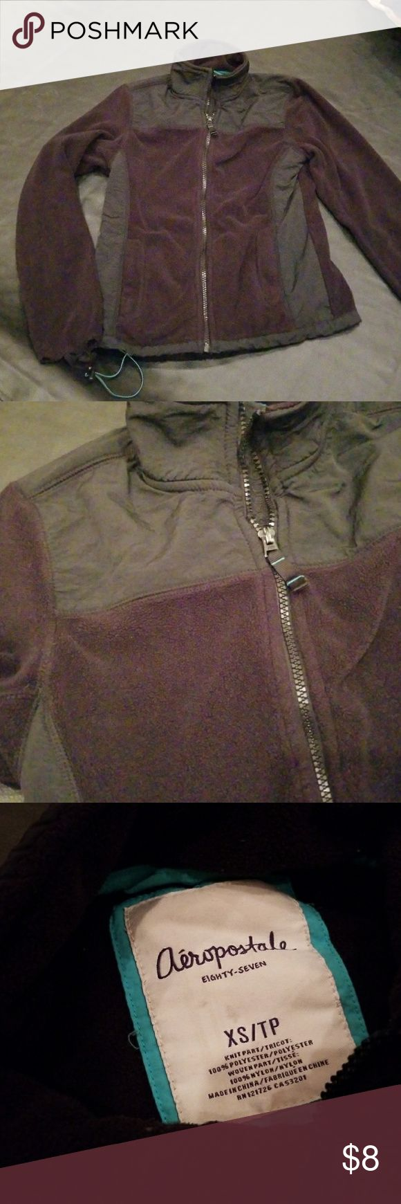 """🔥5 for $15🔥AERO FLEECE Zip Up Jacket God condition other than sleeve piping coming off.cpuld be removed fully. 1 of 2 bungee underneath is broken.  Doesn't impact wear. 🔥5 for $15🔥(ANY 5 listings marked 5 for $15) 😉EARN EXCLUSIVE """"REWARDS DOLLARS"""" WITH EVERY PURCHASE.   💍Also CHECK OUT my $5 for $25 SALE💕    Why SHOP MY Closet? 💋Most NWT or Worn Once 💋Smoke/ Pet Free 💋OVER 550 🌟🌟🌟🌟🌟RATINGS & RISING! 💋TOP 10% Seller  💋TOP RATED 💋 FAST SHIPPER  💋BUNDLES 20% OFF 💋EARN…"""