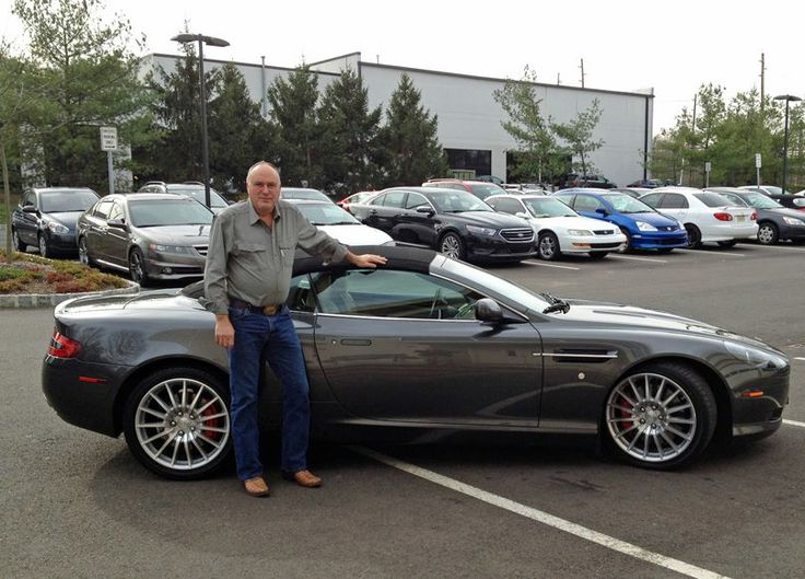 Aston Martin DB9 Volante found a new owner today. Here they are about to set off for Ohio. Should be a fast, fun trip.  SOLD