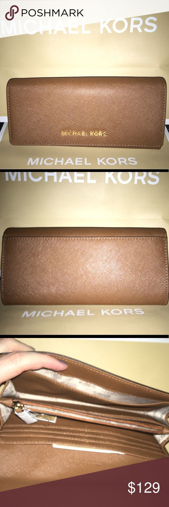Michael Kors Jet Set Travel Wallet NWT Michael Kors Jet Set Travel Wallet! MK carryall design and water and scratch-resistant saffiano leather in signature luggage brown color! Stainless-steel, gold-toned Michael Kors lettering. 10 internal card slots, 1 internal zip-close pocket, 2 side internal slip pockets, 2 internal open compartments, and 1 external back slip picket. Light-tan internal linen lining for easy-finding of belongings. Snap-closure.  Item code: 35H6GYAE3L Michael Kors Bags…