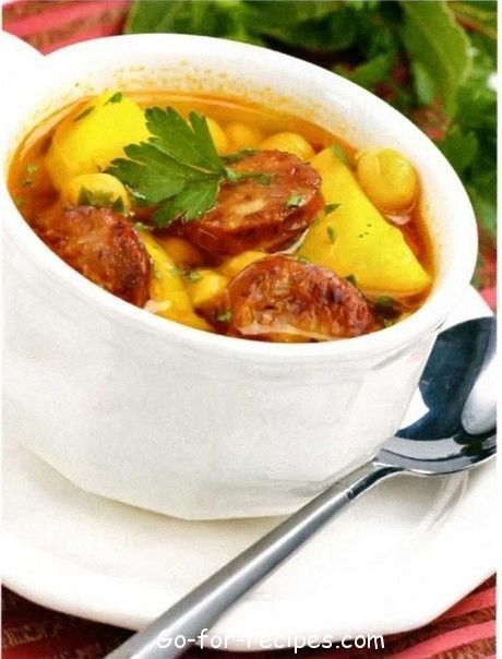 Tomato soup with sausages and beans.