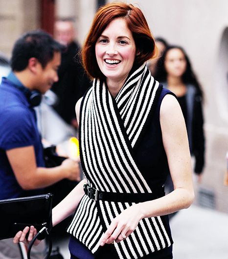 Taylor Tomasi Hill  Leave it to Taylor Tomasi Hill to riff on a classic menswear trick.  Traditionally worn under a tailored jacket, this criss-cross style is turned into the centerpiece of the look, with a heavier weight scarf and a belt to wrangle it in.
