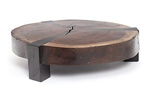 A coffee table made of a crosscut of reclaimed Tamburiuva wood